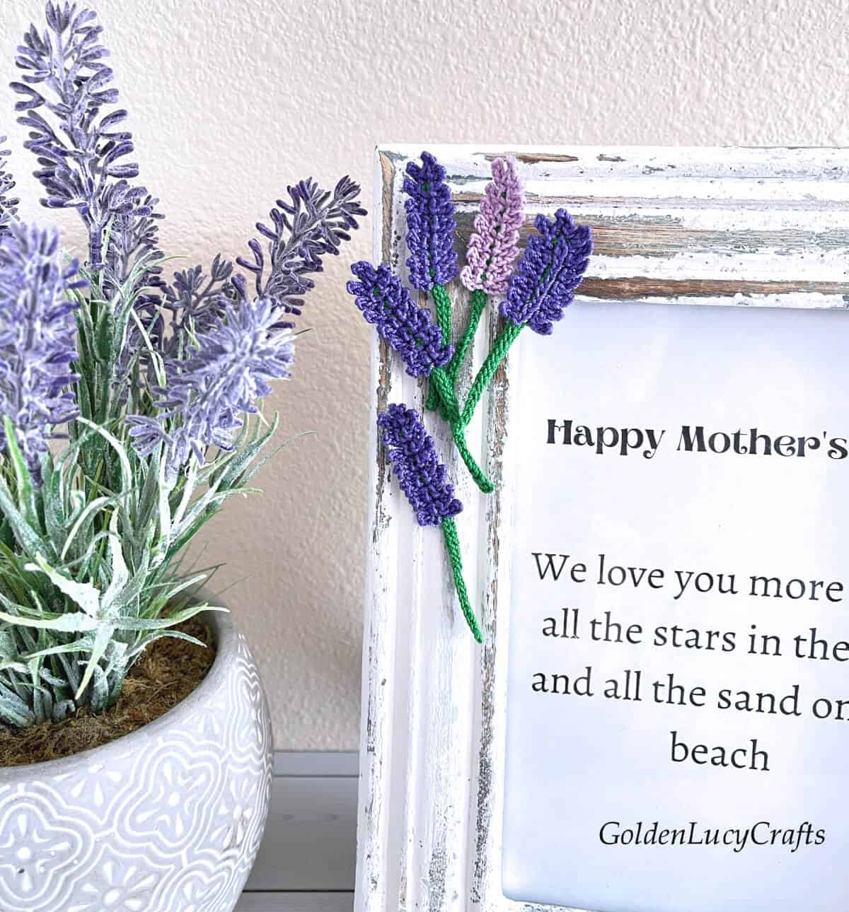 Mother's Day picture frame embellished with crochet lavender flowers, lavender in a pot next to it, close up picture.