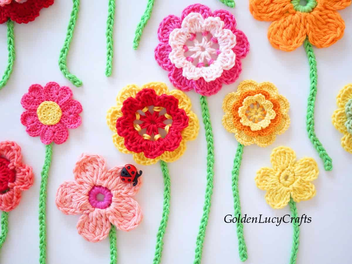 Crocheted flowers on canvas wall art, close up picture.