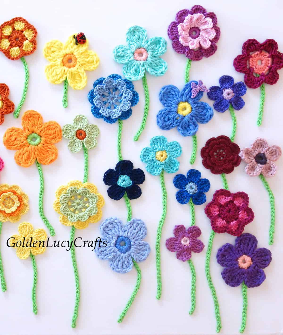 Crocheted flowers with stems applique.