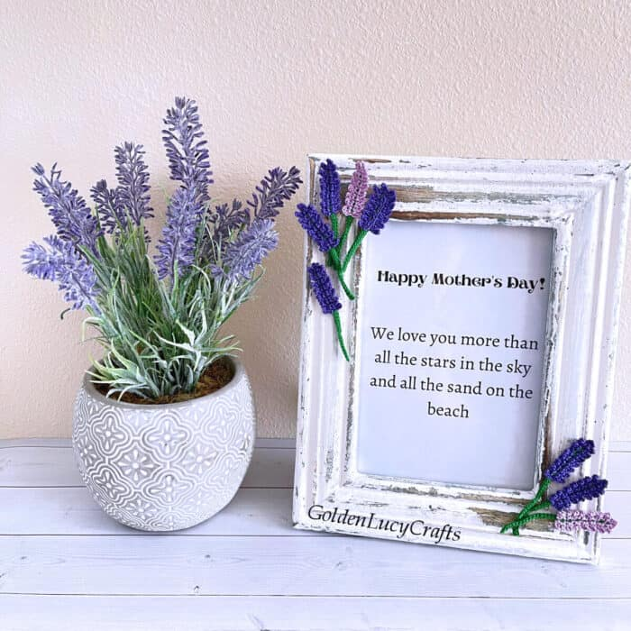 Mother's Day picture frame embellished with crochet lavender flowers, lavender in a pot next to it.
