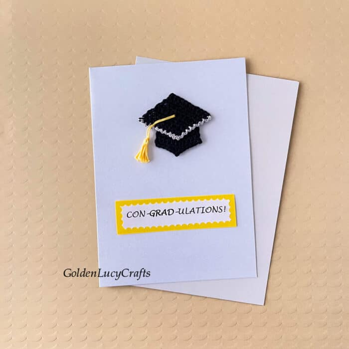 Handmade card with crochet graduation cap on it and note saying Congradulations.