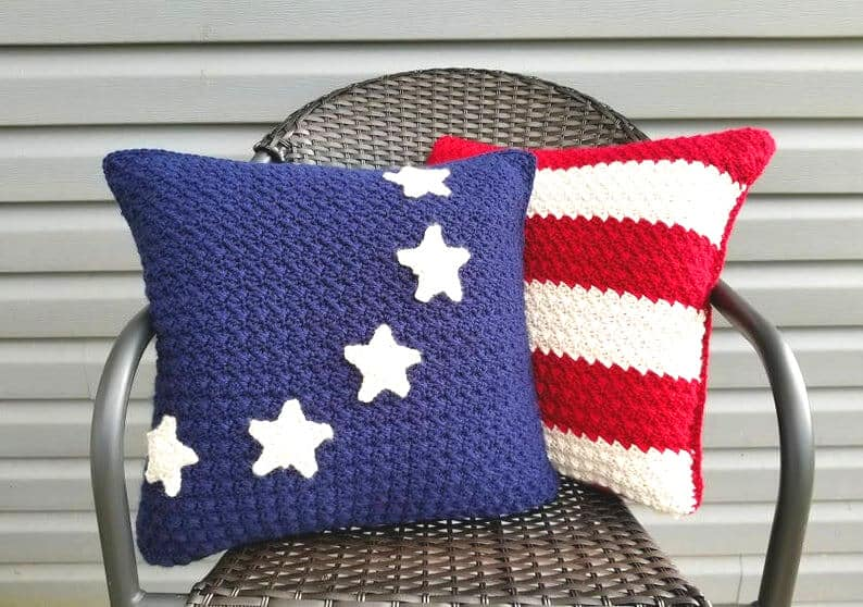 Two crocheted patriotic pillows on the chair.