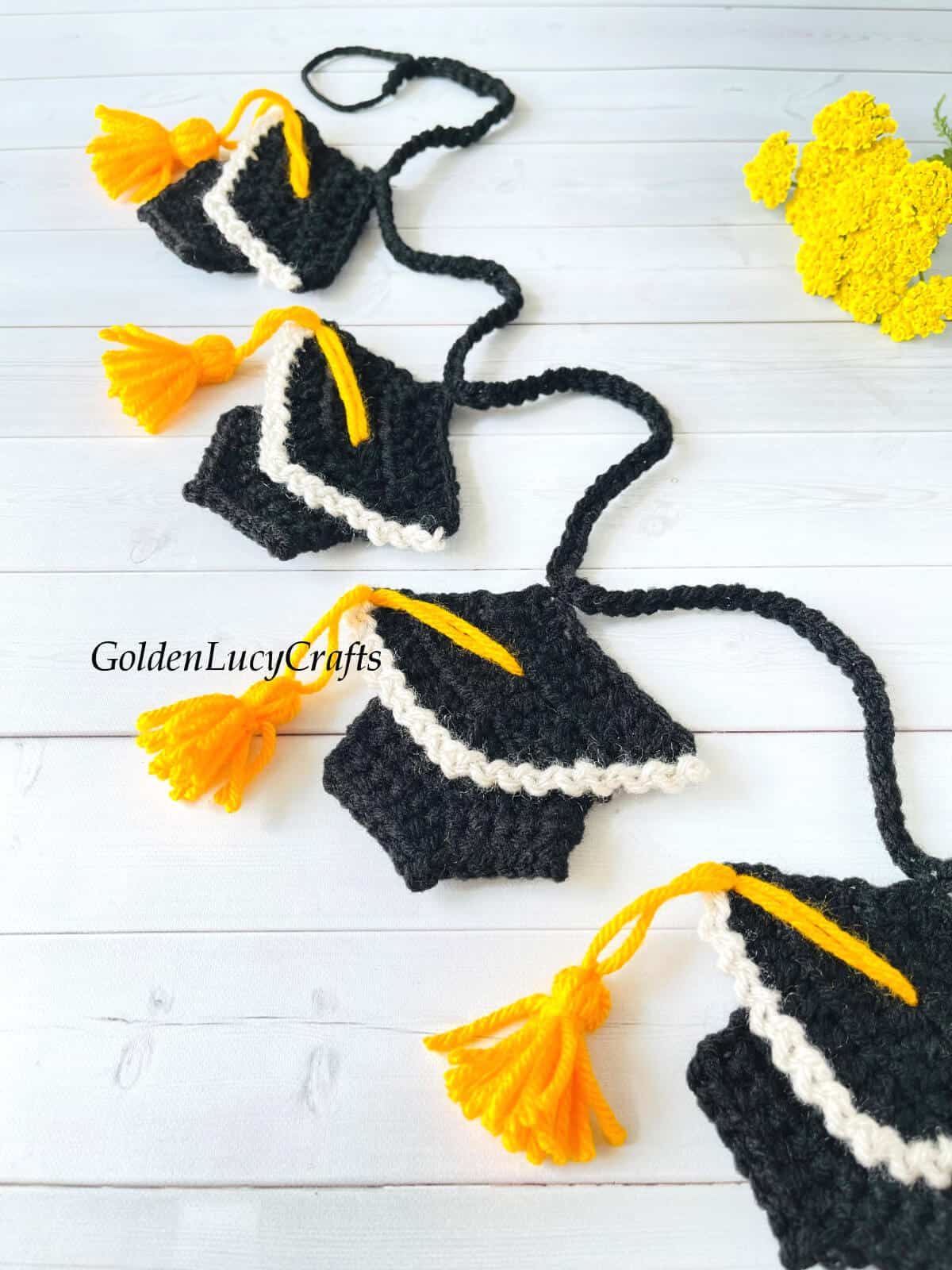 Crocheted graduation garland close up picture.