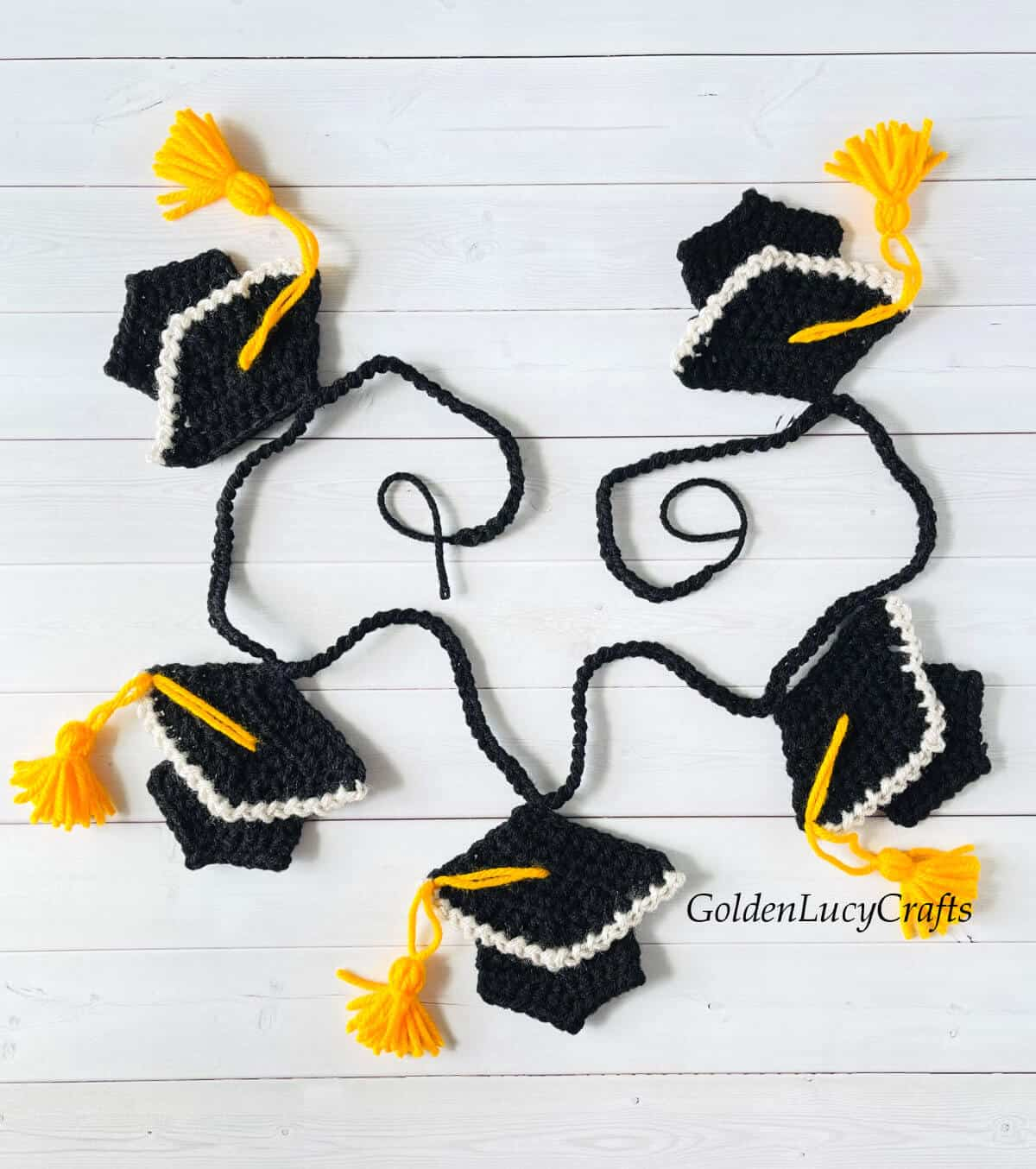 Crocheted graduation garland laying on the surface.