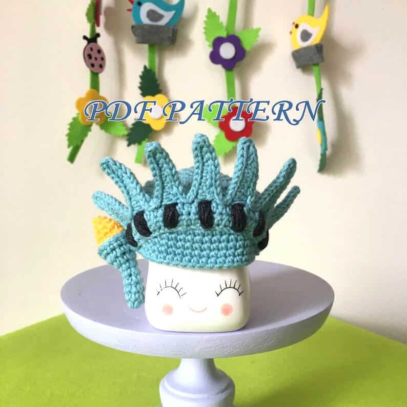 Crocheted statue of liberty marshmallow mag hat.