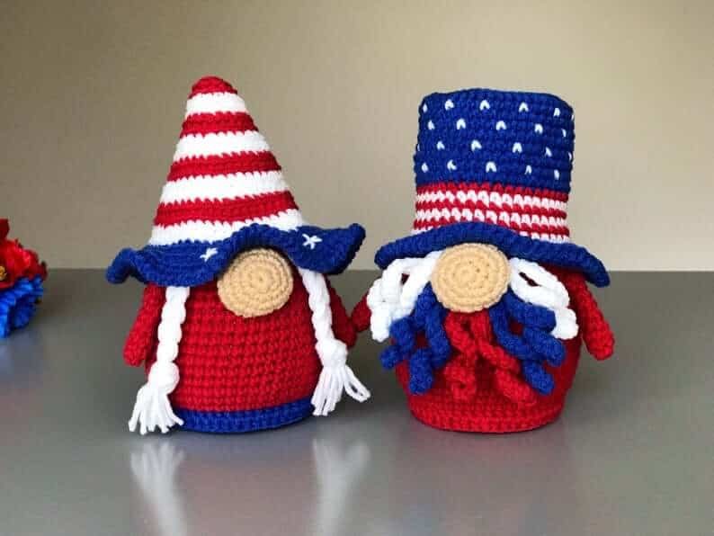 Two crocheted gnomes for the 4th of July in red, white and blue colors.