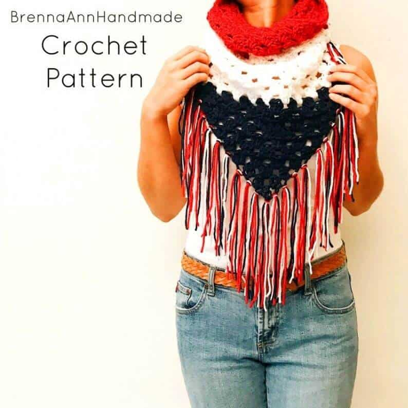 Model dressed in crocheted shawl.
