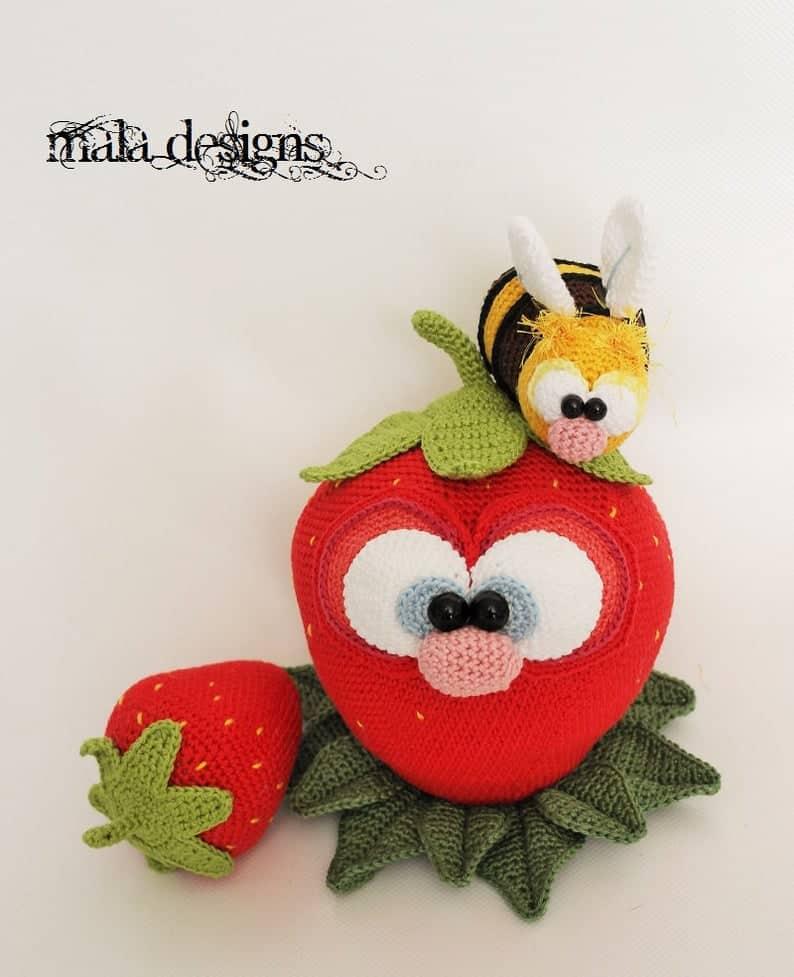Crocheted strawberry amigurumi, crocheted bees.