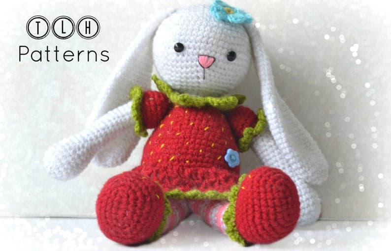 Crocheted bunny in red dress and shoes.