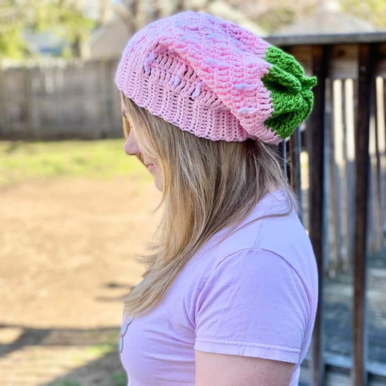 Model wearing pink hat.