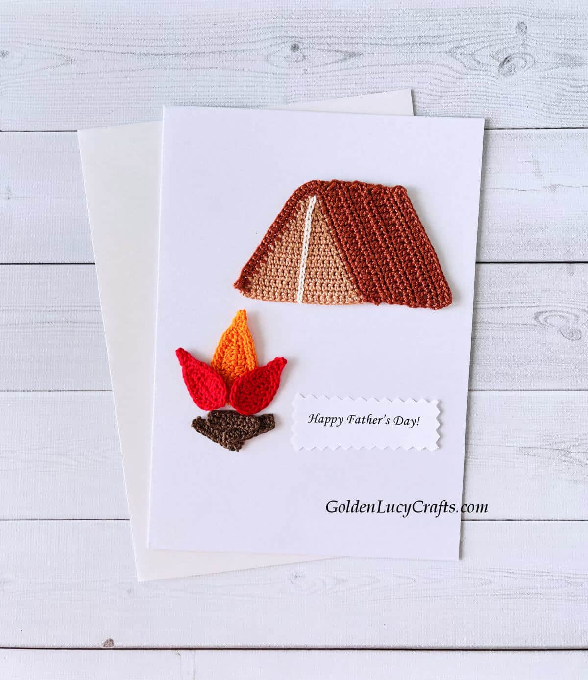 """Crochet camping applique on a white card with the text """"Happy Father's Day!"""""""