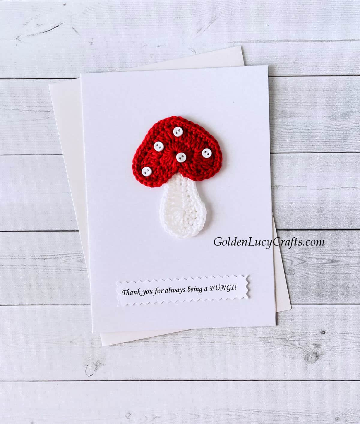 """Crochet mushroom on a white card with the text """"Thank you for always being a fungi!"""""""