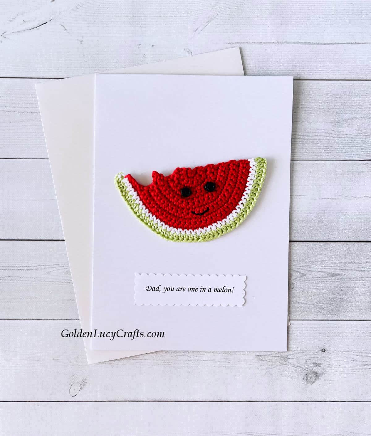 """Crochet watermelon slice applique on a white card with the text """"Dad, you are one in a melon!"""""""