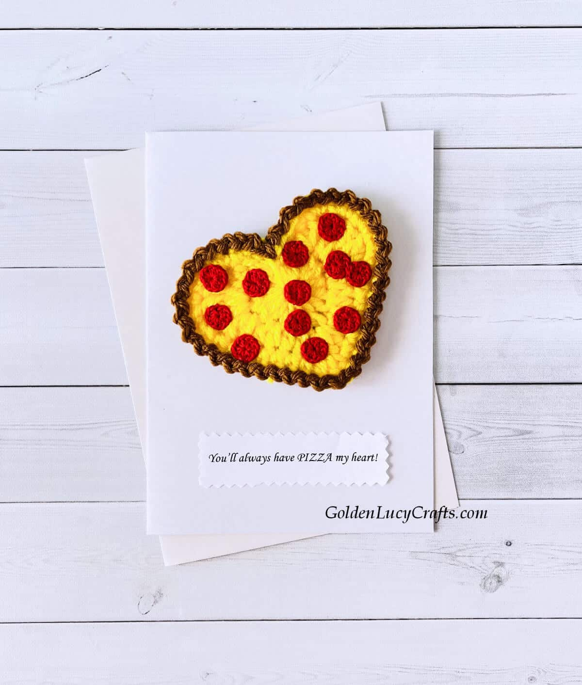"""Crochet heart pizza applique on a white card with the text """"You'll always have pizza my heart!"""""""