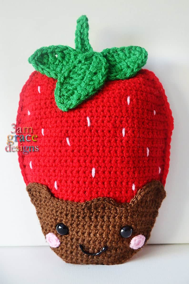 Large crocheted strawberry dipped in chocolate.