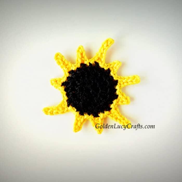 Crocheted total solar eclipse applique.