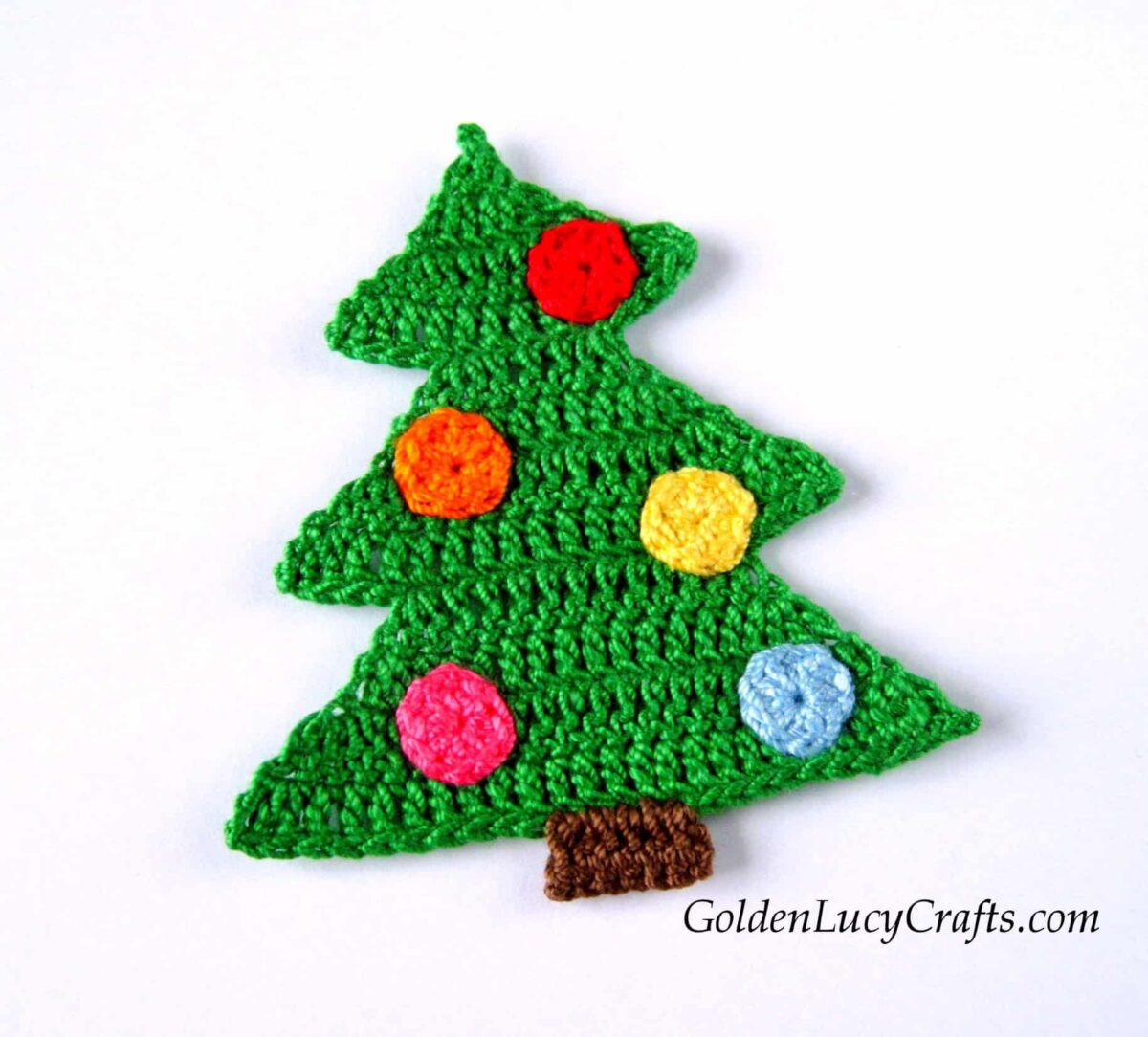 Crocheted green Christmas tree applique with round colorful ornaments.
