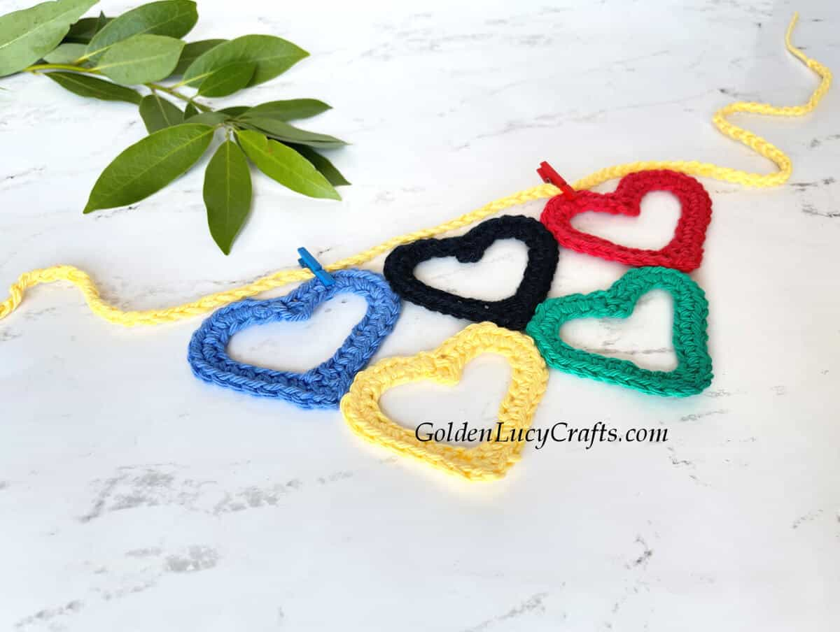 Crocheted Olympic garland made from heart-shaped Olympic rings.