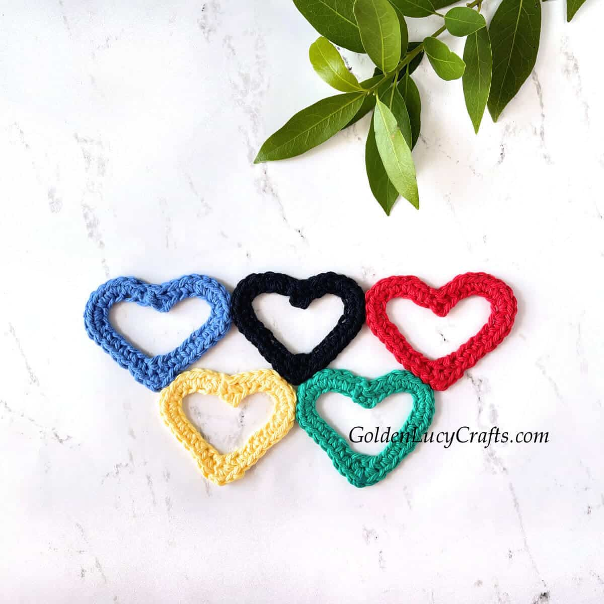 Crocheted heart-shaped Olympic rings applique.