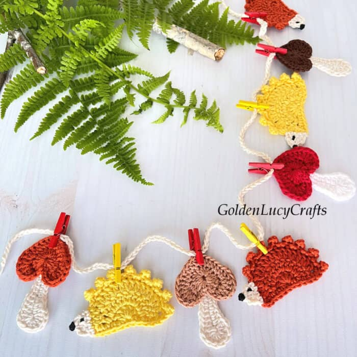 Crocheted mushrooms and hedgehogs bunting.