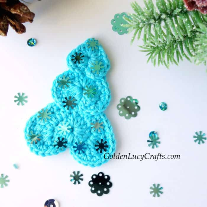 Crochet Christmas tree in turquoise color.
