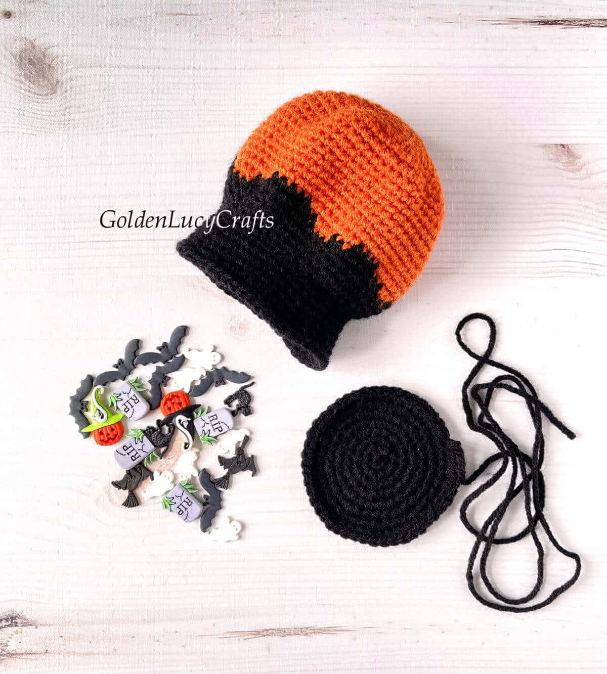 Parts of crocheted snow globe, Halloween themed craft buttons.