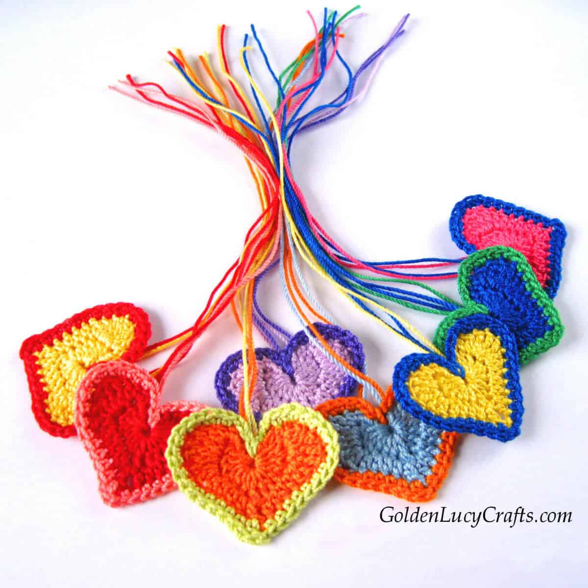 Bunch of crocheted colorful hearts.