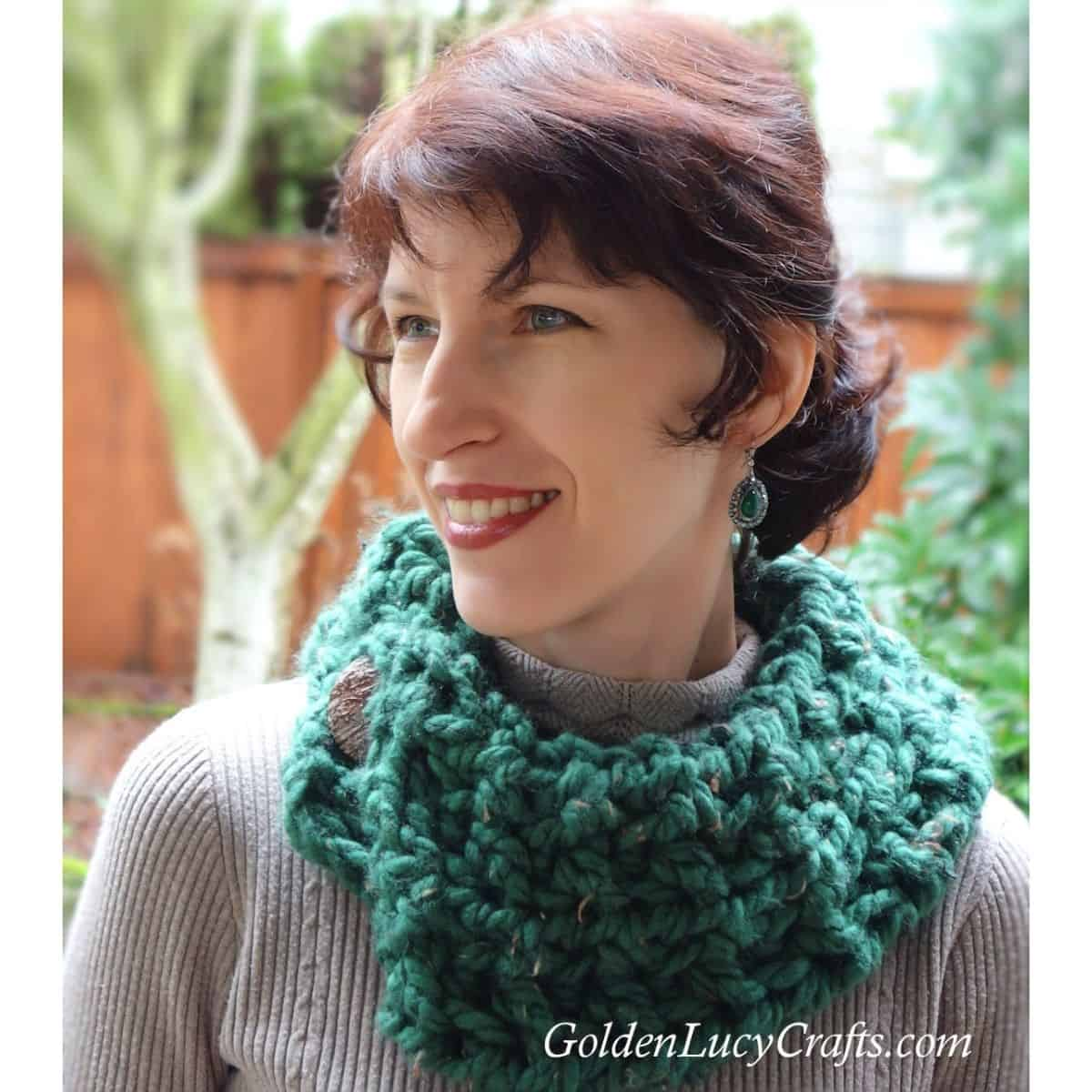 Model dressed in green cowl.