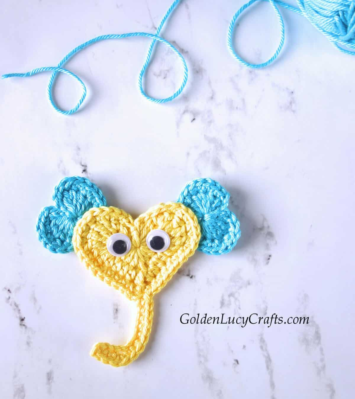 Heart-shaped elephant applique in yellow with blue ears.