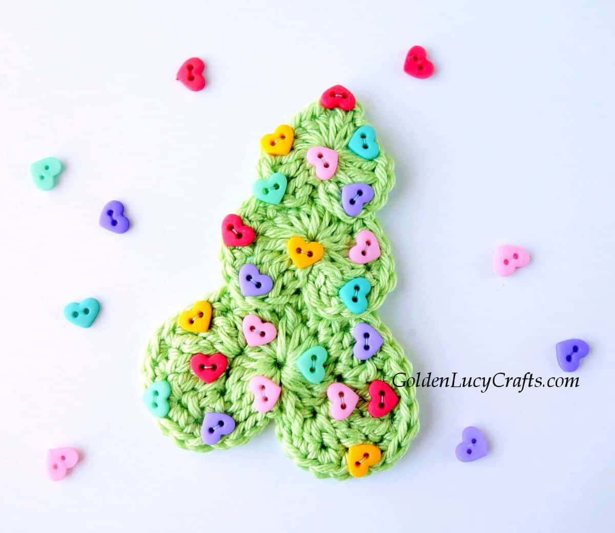 Green crocheted Christmas tree embellished with tiny heart-shaped buttons.