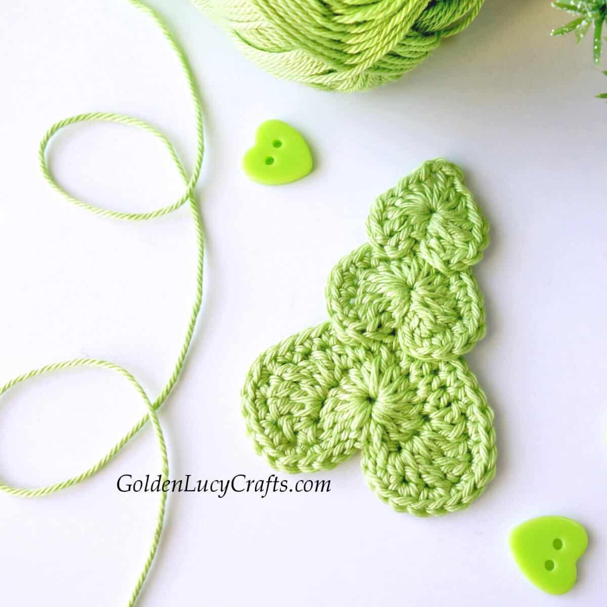 Green crochet Christmas tree applique.