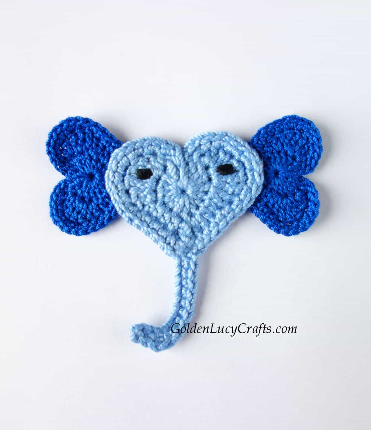 Heart-shaped crocheted elephant applique in blue color.