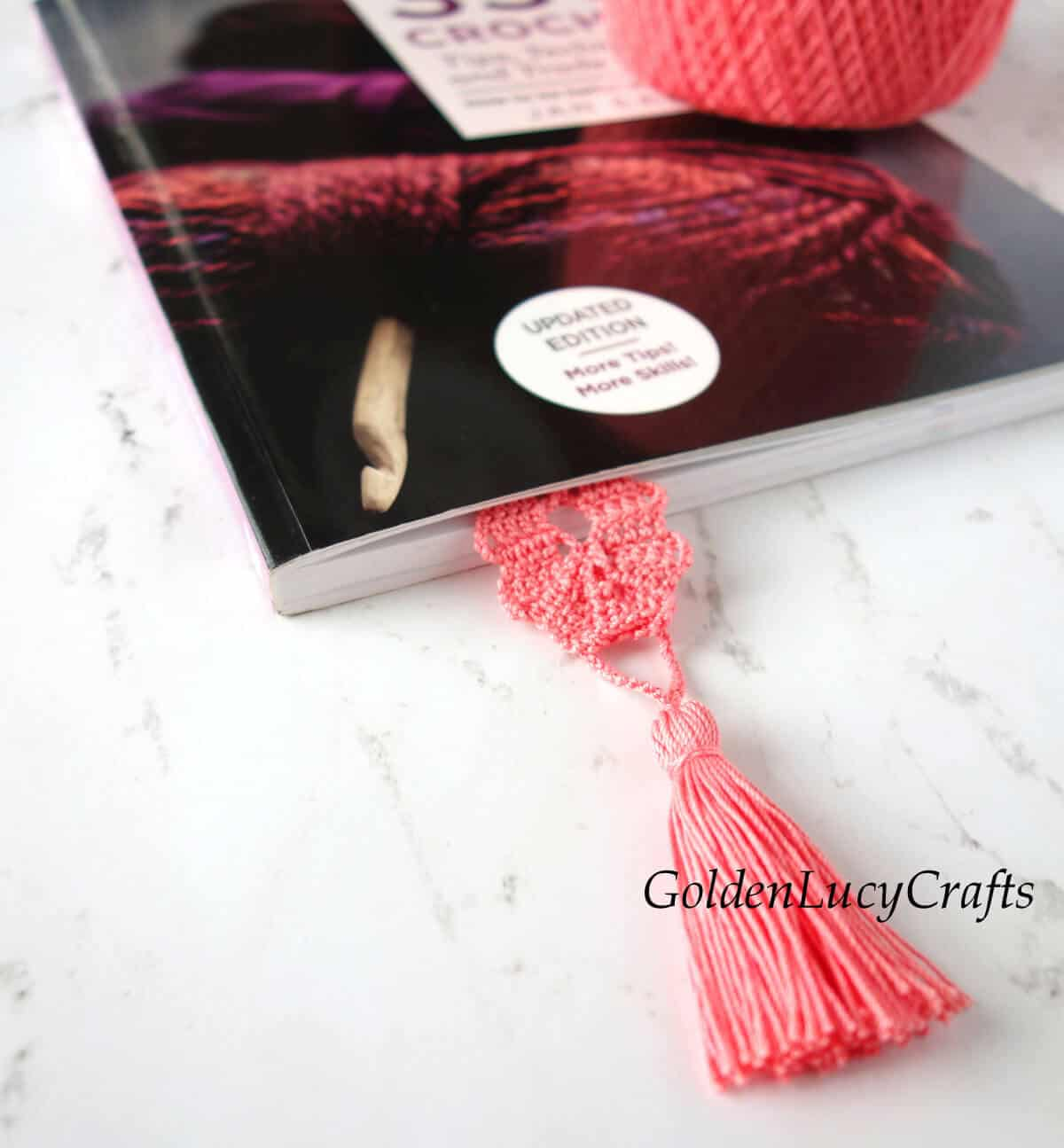 Book with crocheted bookmark in it.