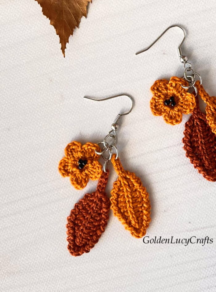 Crocheted fall themed earrings close up picture.