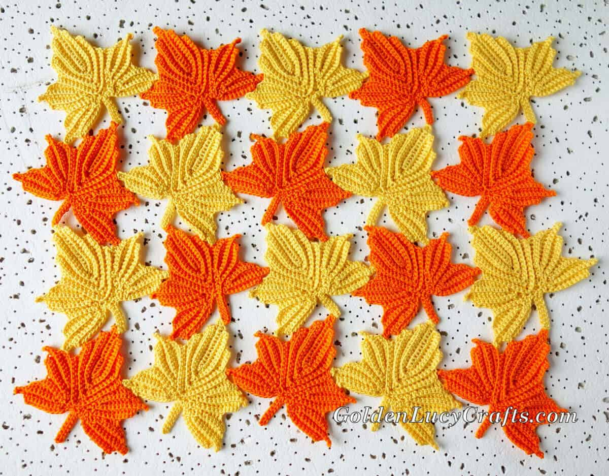 Crocheted maple leaves in yellow and orange colors.