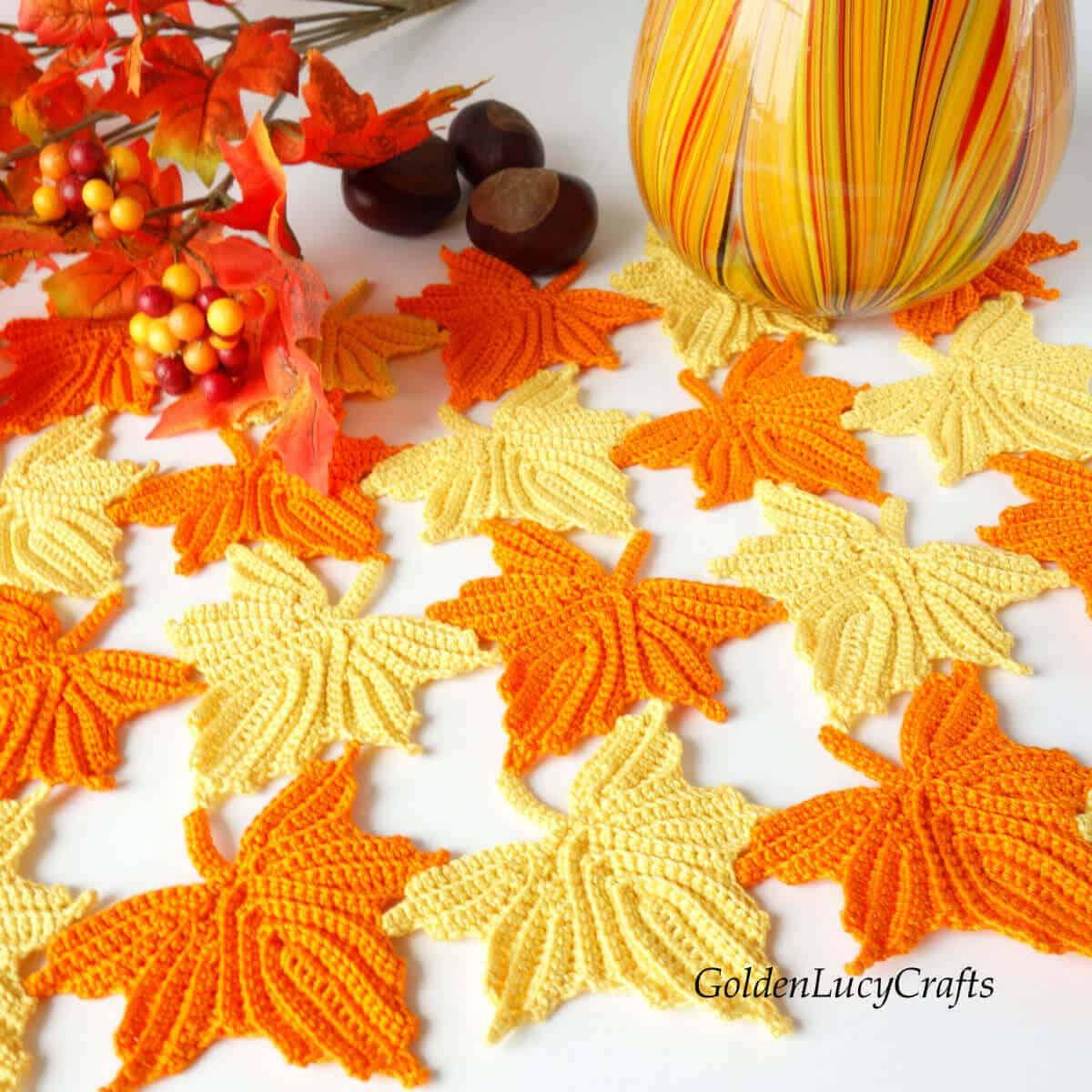 Crochet maple leaves table decoration.