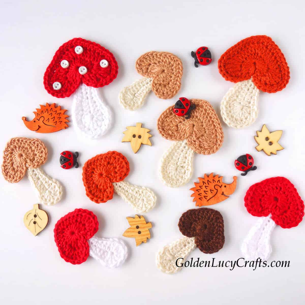 Crocheted mushroom appliques and craft buttons.