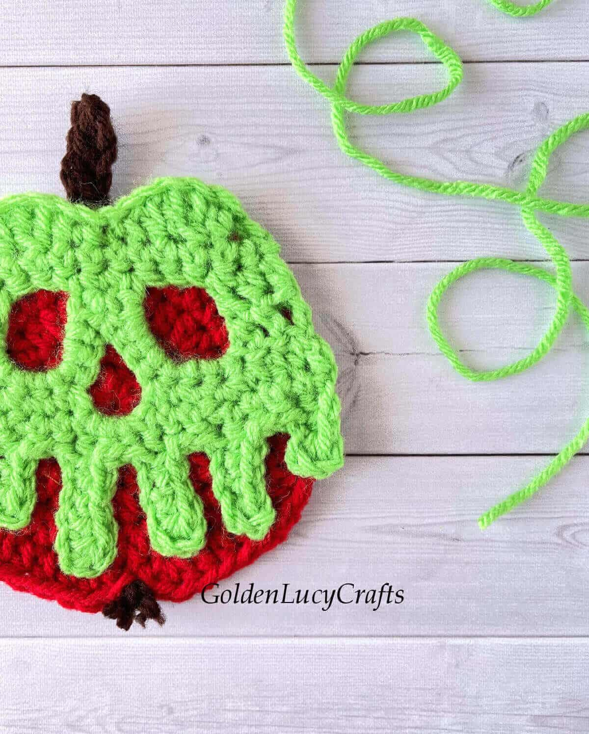Crocheted poisoned apple close up.