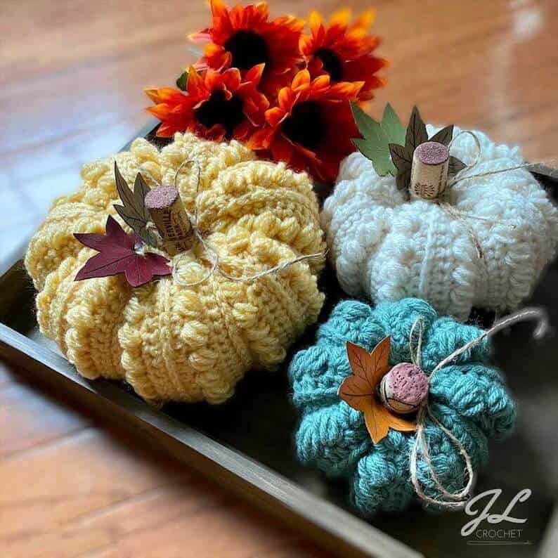 Crocheted pumpkins on a tray.