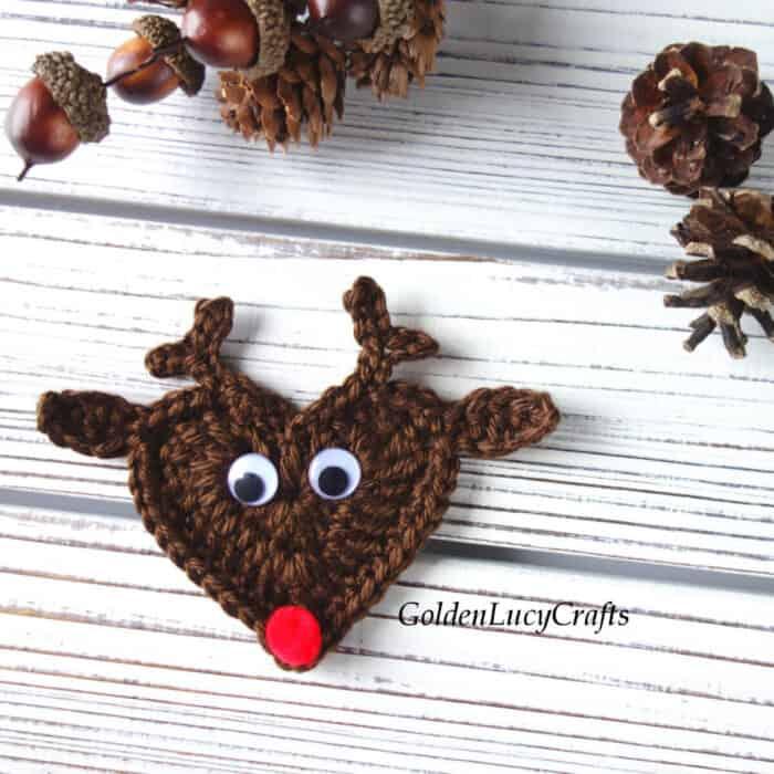 Crochet heart-shaped reindeer applique.