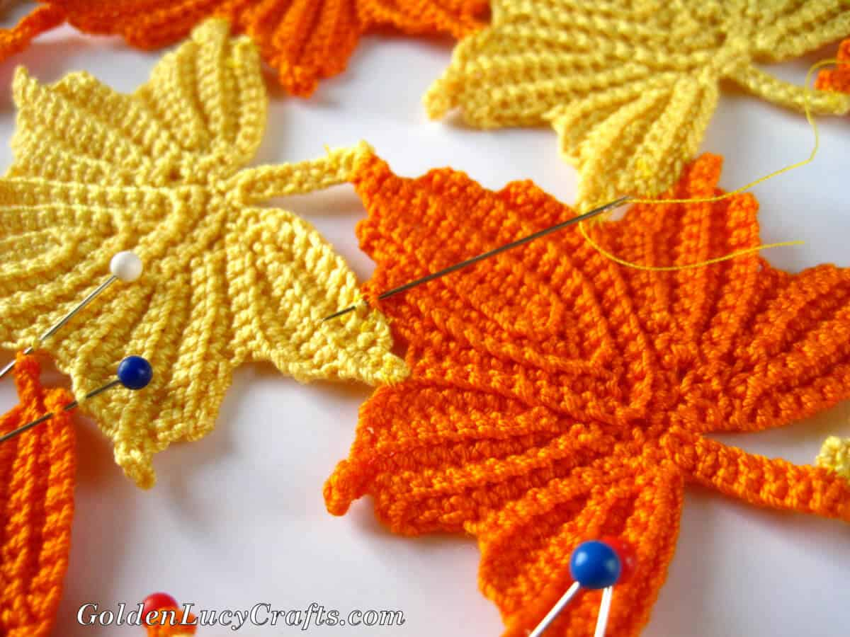 Process shot - making table decor from crocheted maple leaves, close up picture.