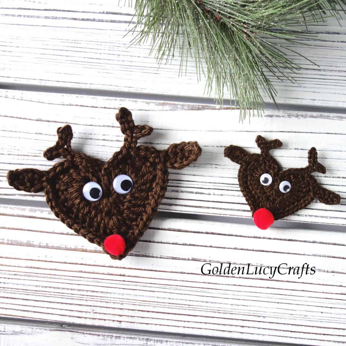 Two crocheted reindeer appliques in different sizes.