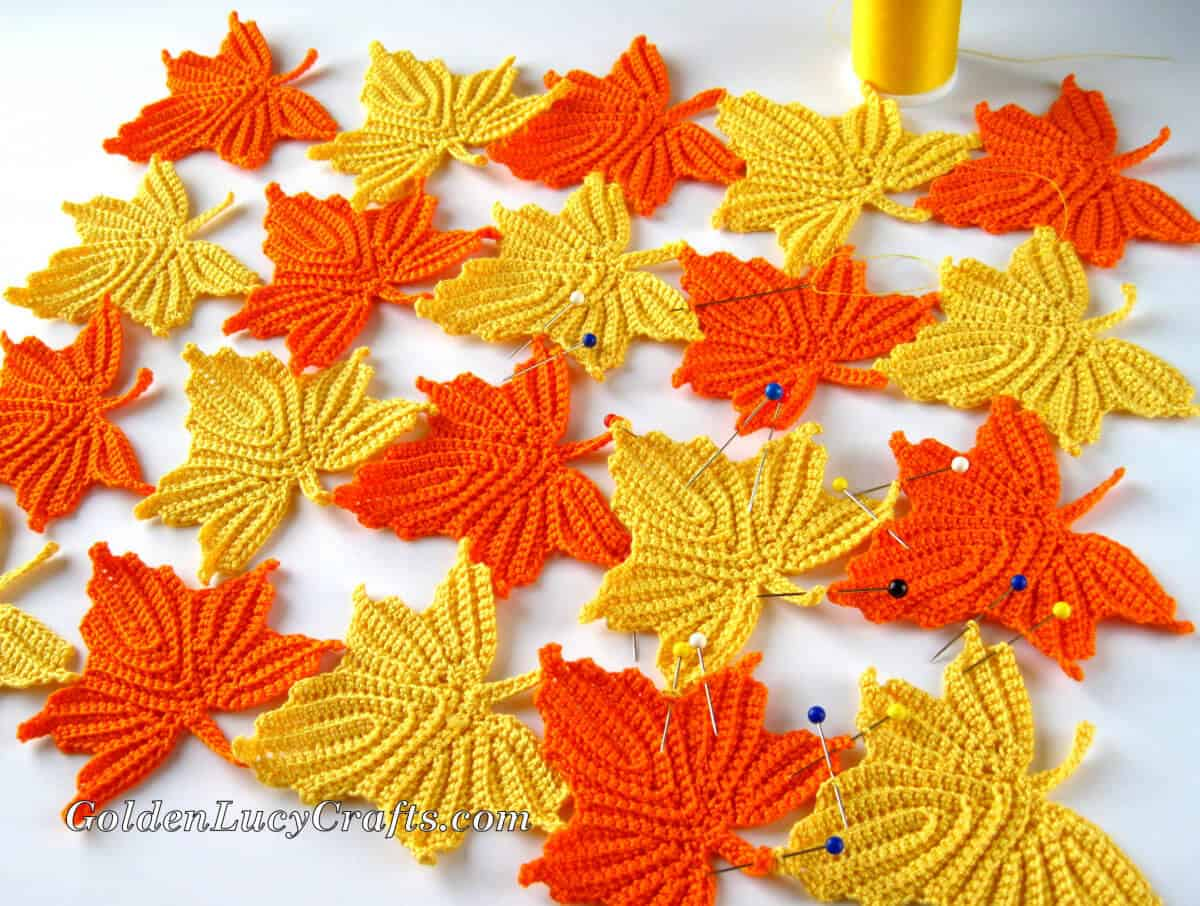 Process shot - making table decor from crocheted maple leaves.