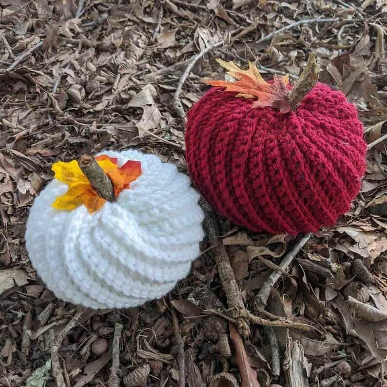 White and dark red crocheted pumpkins.