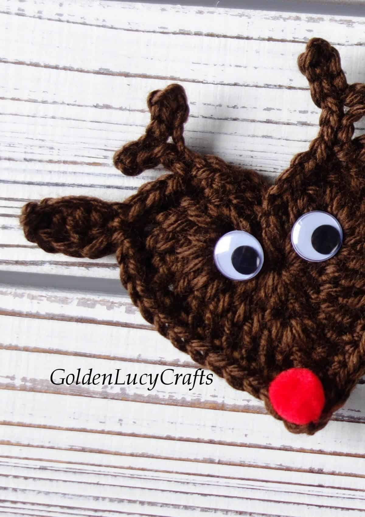 Crocheted reindeer applique close up picture.