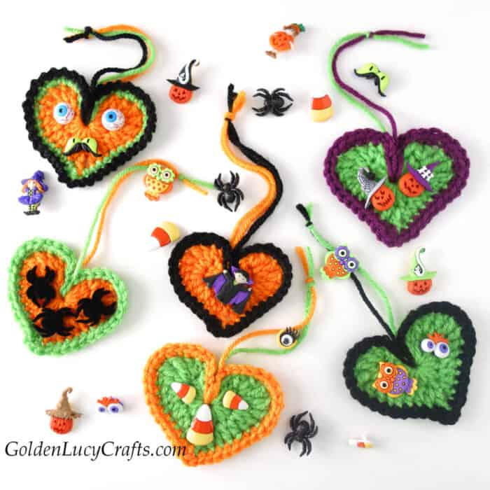 Crocheted Halloween heart ornaments embellished with Halloween themed buttons.